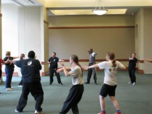 photo of a group of students learning tai chi chuan