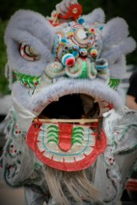 photo of the front face of a silver lai tung pai kung fu lion dancing costume