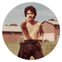 photograph of grandmaster Li throwing a straight right punch