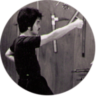 photograph of sifu li throwing a right cross punch